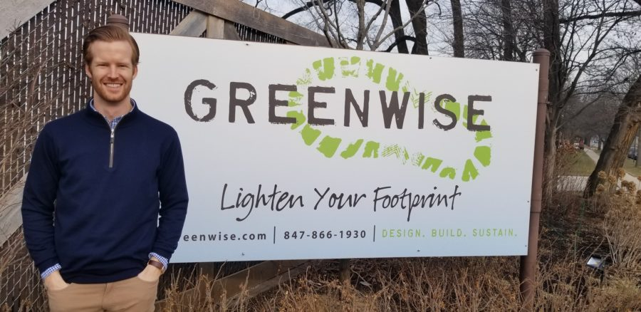 Austin Hall standing in front of Greenwise sign
