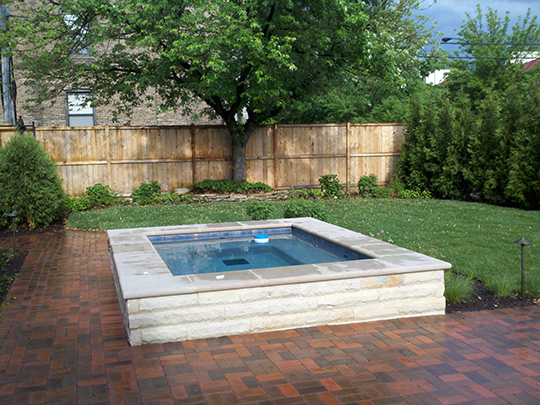 Traditional Plantings With Boxwoods And A Japanese Maple Add Year Round  Interest. The Clean, Modern Lines Of The Patio Are Softened With Native  Grasses.